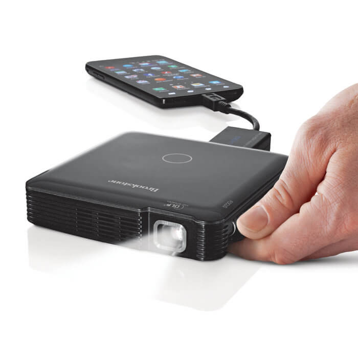 Brookstone 39 s new pocket projector a good excuse for movie for Bluetooth projector for iphone