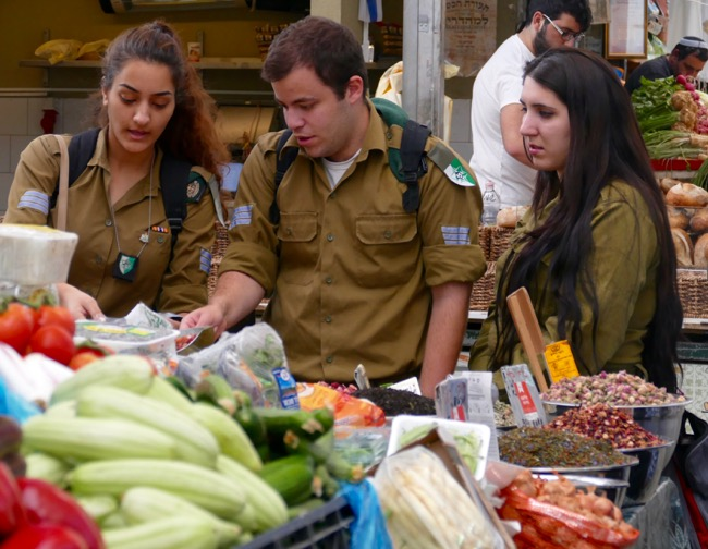 Soldiers shopping at Machane Yehuda Market in Jerusalem Israel