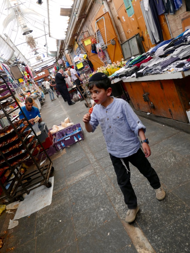 kids at Machane Yehuda Market in Jerusalem Israel
