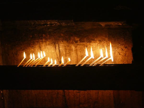 Candles lit outside Christ's tomb in the Church of the Holy Sepulchre