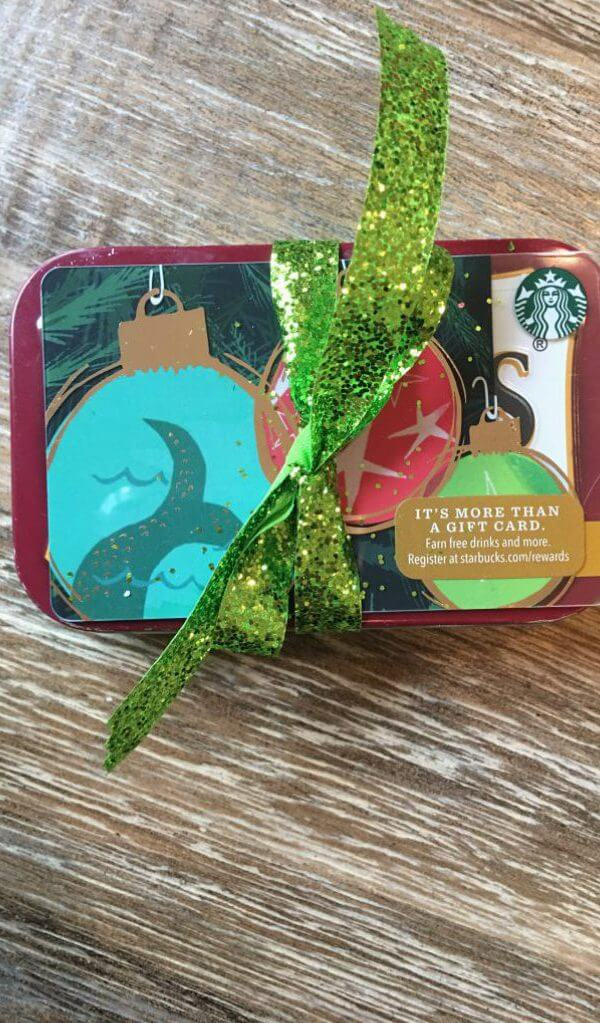 holiday gift of gift card plus recycled gift card guitar picks in a tin